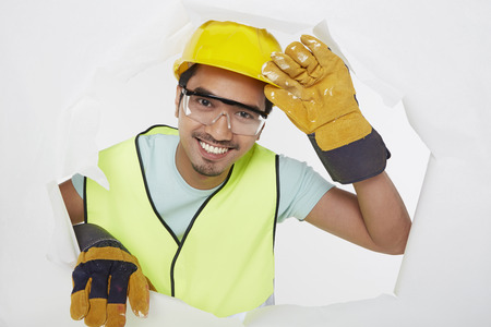 Construction worker smiling at the camera photo