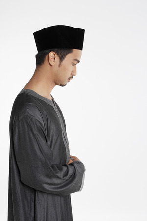 reciting: Man putting his right hand on top of the left hand, placing it against his chest