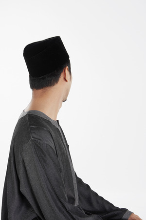 reciting: The ending salam, facing left Stock Photo
