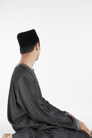 reciting: The ending salam, facing left Stock Photo