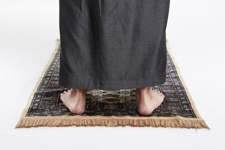 Man facing the Qiblah with the intention of performing prayer
