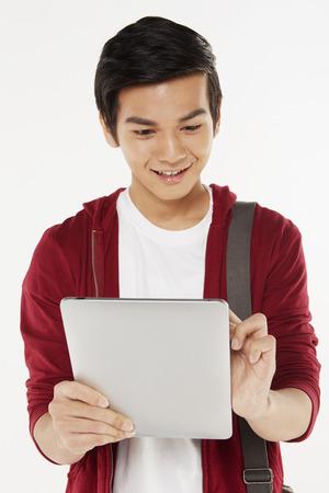 Man using a digital tablet Stock Photo