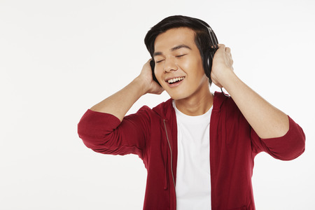 Man listening to music on the headphone photo