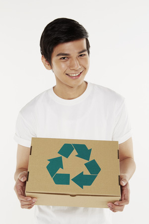 Man holding a recyclable cardboard box photo