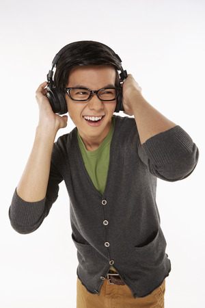 Man listening to music on the headphone photo