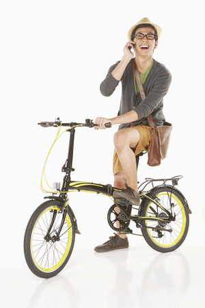 Man talking on the phone while sitting on the bicycle