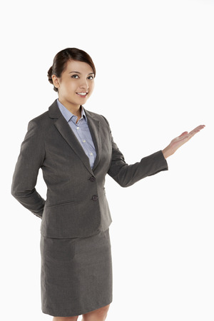 Cheerful businesswoman showing hand gesture photo