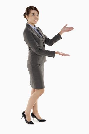 hand gesture: Cheerful businesswoman showing hand gesture
