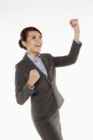 Businesswoman cheering with fists in the air photo