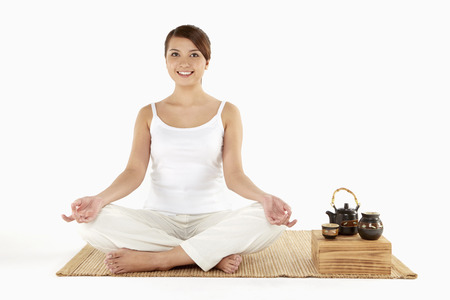 Woman sitting and meditating photo