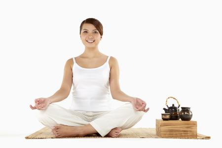 Woman sitting and meditating photo