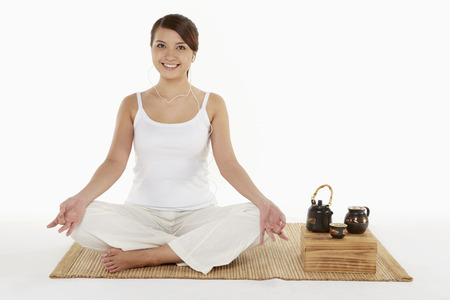Woman meditating with earphones on photo