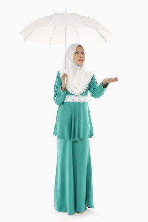 Woman in traditional clothing holding an umbrella