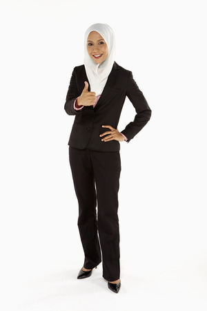 Businesswoman giving thumbs up photo