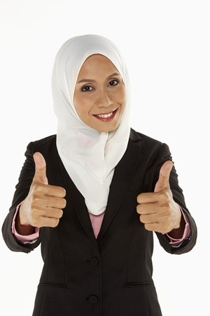 thumbsup: Businesswoman giving two thumbs up Stock Photo