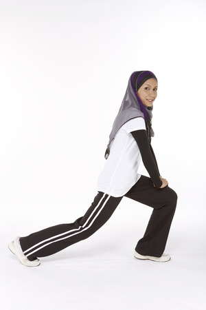 lunges: Woman doing lunges, facing left