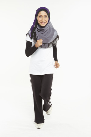 Woman in a jogging position photo