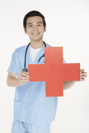 cur: Medical personnel holding a cur out cross sign Editorial