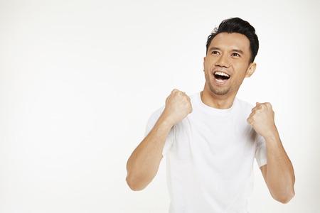 Portrait of man cheering photo