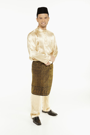 Man in traditional clothing, standing and smiling photo