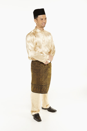 Man in traditional clothing, standing and smiling Stock Photo