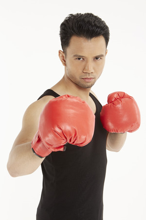 Man wearing boxing gloves photo