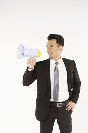 Businessman shouting into a megaphone photo