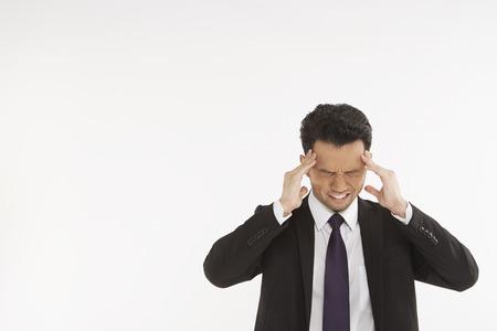 eyes closing: Businessman having a headache Stock Photo