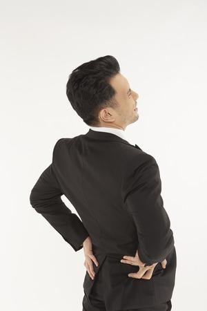 back ache: Businessman having a back ache