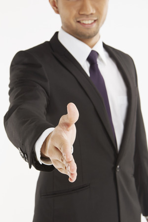 Businessman with hand held out