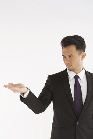 hand gesture: Businessman showing hand gesture Stock Photo