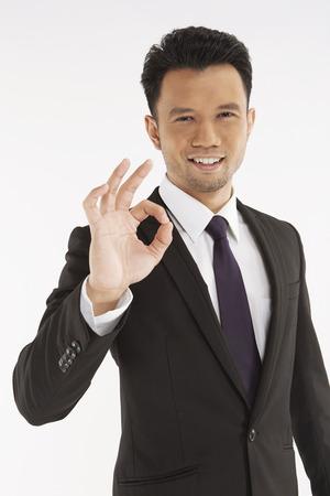 Businessman showing hand gesture Stock Photo