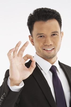 Businessman showing hand gesture photo
