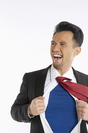 ripping shirt: Businessman ripping off his shirt