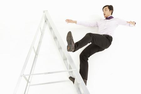Businessman falling off a ladder Stock Photo - 22833729