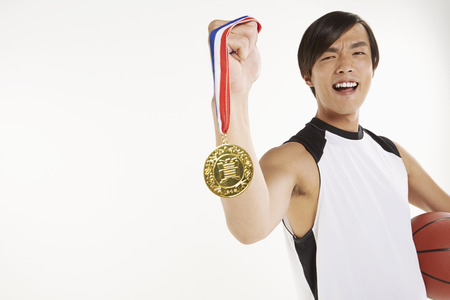 Man holding a gold medal photo