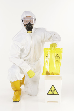 Man in protective suit disposing biohazard waste Stock Photo - 22844575