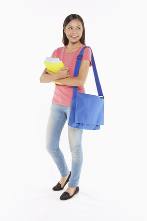 Woman carrying books and a sling bag photo