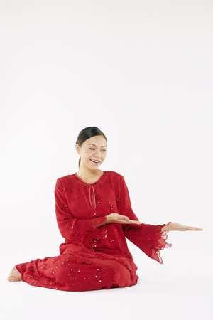 Woman in traditional clothing showing hand gesture photo