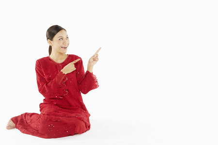 hand gesture: Woman in traditional clothing showing hand gesture Stock Photo