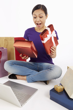 Woman opening up a gift box photo
