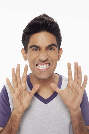 Man showing a scary gesture