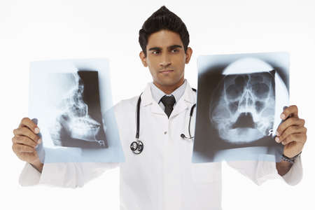 medical personnel: Medical personnel examining x-ray films