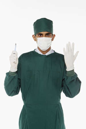Medical personnel holding a scalpel photo