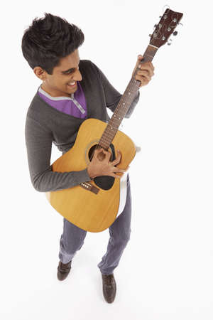 musically: Man playing with a guitar