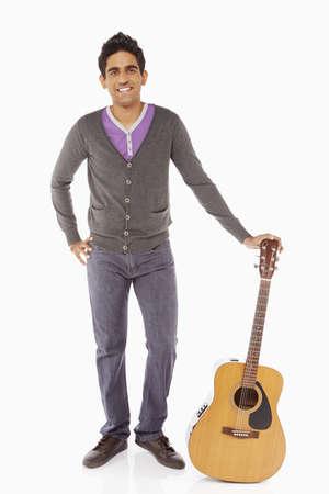 musically: Man holding a guitar