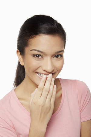giggling: Woman giggling at the camera Stock Photo
