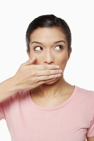 Woman covering her mouth photo