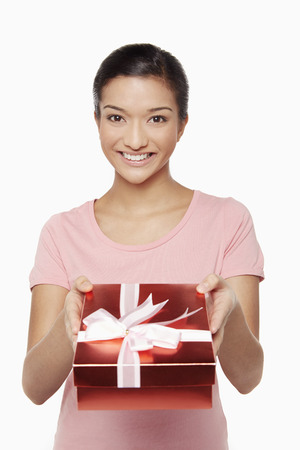 Woman holding a red gift box photo