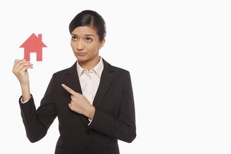 ritagliare: Imprenditrice in possesso di una casa tagliare